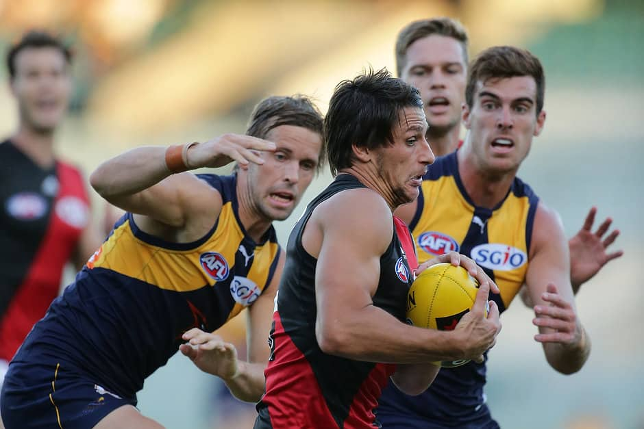PERTH, AUSTRALIA - MARCH 13: Mark Baguley of the Bombers marks the ball during the 2016 NAB Challenge match between the West Coast Eagles and the Essendon Bombers at Domain Stadium, Perth on March 13, 2016. (Photo by Will Russell/AFL Media)