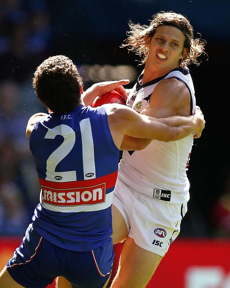 Returning star Tom Liberatore lays a strong tackle on Nat Fyfe - ${keywords}