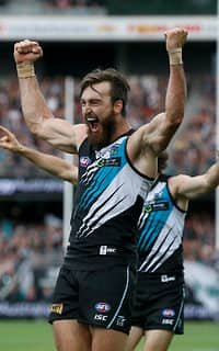 Charlie Dixon celebrates a late goal in the win over St Kilda
