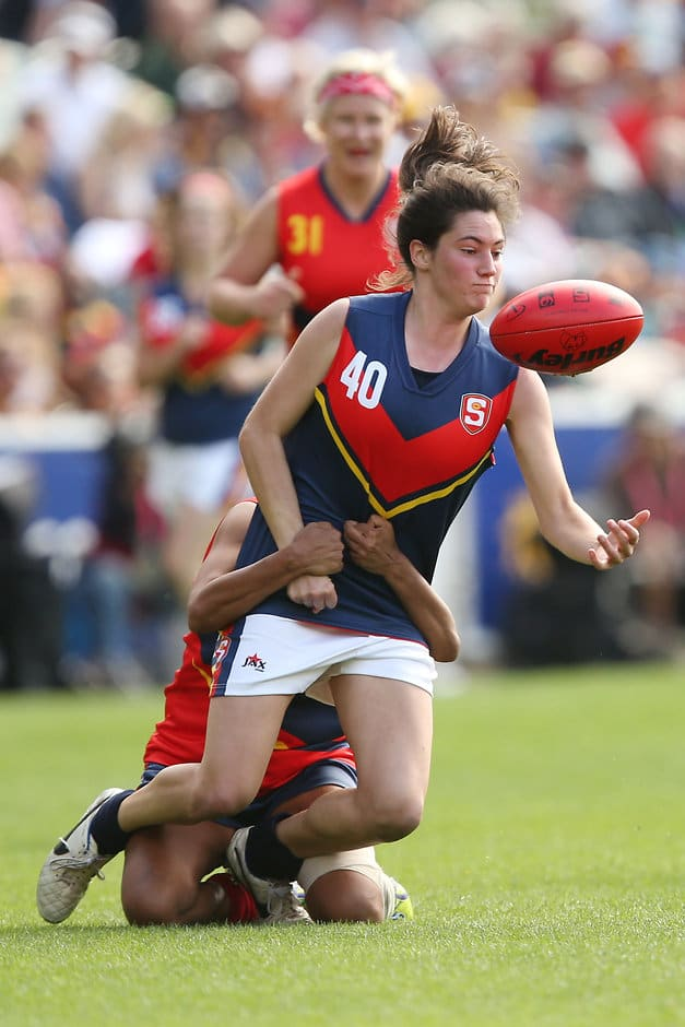 MELBOURNE, AUSTRALIA - APRIL 2: Rachael Killian of SA Blue is tackled by Bronwyn Davey of SA Red during the SANFL All Stars Womens match at Adelaide Oval in Adelaide, Australia on April 2, 2016. (Photo by James Elsby/AFL Media)