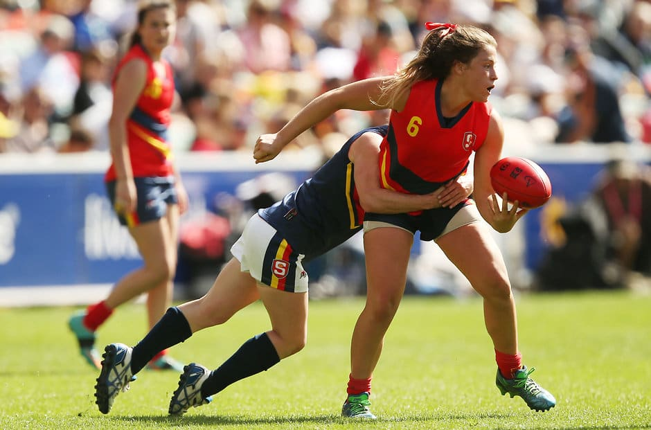 MELBOURNE, AUSTRALIA - APRIL 2: Angela Moritz of SA Blue tackles Georgia Bevan of SA Red during the SANFL All Stars Womens match at Adelaide Oval in Adelaide, Australia on April 2, 2016. (Photo by James Elsby/AFL Media)
