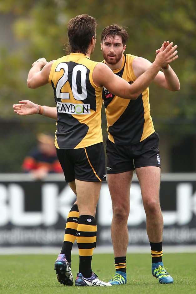 MELBOURNE, AUSTRALIA - APRIL 16:  Liam Mcbean of Richmond celebrates a goal during the round two VFL match between the Richmond Tigers and the Footscray Bulldogs at Punt Road Oval on April 16, 2016 in Melbourne, Australia.  (Photo by Jack Thomas/AFL Media/Getty Images)