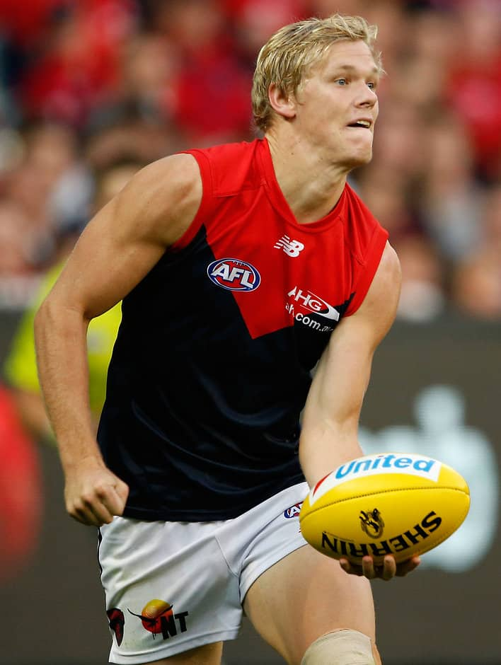 MELBOURNE, AUSTRALIA - APRIL 17: Josh Wagner of the Demons handpasses the ball during the 2016 AFL Round 04 match between the Collingwood Magpies and the Melbourne Demons at the Melbourne Cricket Ground, Melbourne on April 17, 2016. (Photo by Adam Trafford/AFL Media)