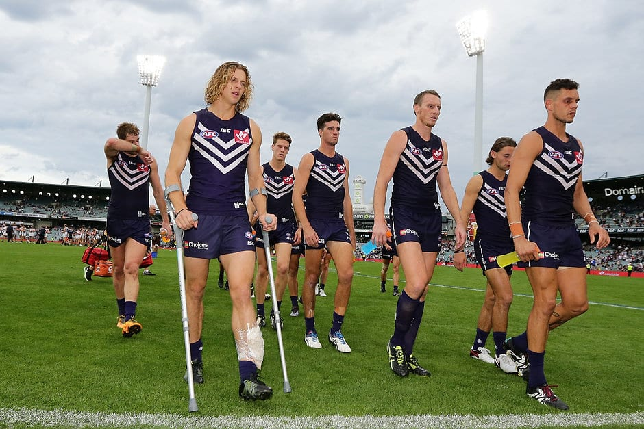 PERTH, AUSTRALIA - APRIL 24: Nathan Fyfe of the Dockers leave the field on crutches after the teams defeat during the 2016 AFL Round 05 match between the Fremantle Dockers and the Carlton Blues at Domain Stadium, Perth on April 24, 2016. (Photo by Will Russell/AFL Media)