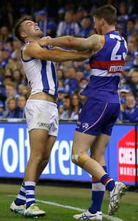 Luke McDonald and Jordan Roughead come to grips with each other on Friday night during the Roos' win