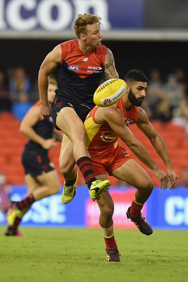 GOLD COAST, AUSTRALIA - MAY 7:  Adam Saad of the Suns spoils the kick of James Harmes of the Demons  during the 2016 AFL Round 07 match between the Gold Coast Suns and the Melbourne Demons at Metricon Stadium, Gold Coast on May 7, 2016. (Photo by Matt Roberts/AFL Media)