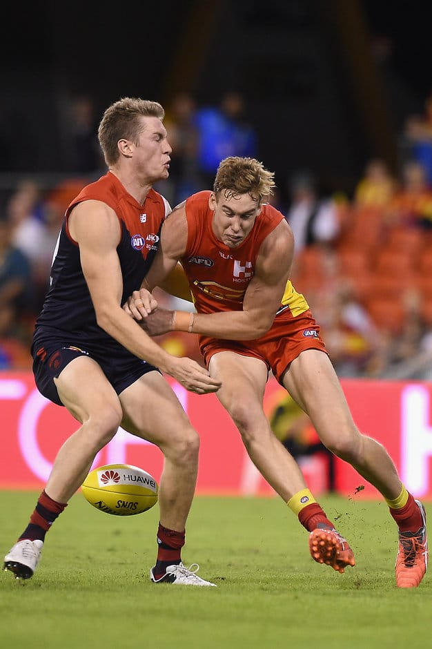 GOLD COAST, AUSTRALIA - MAY 7:  Tom Lynch of the Suns competes for the ball against Tom McDonald of the Demons during the 2016 AFL Round 07 match between the Gold Coast Suns and the Melbourne Demons at Metricon Stadium, Gold Coast on May 7, 2016. (Photo by Matt Roberts/AFL Media)