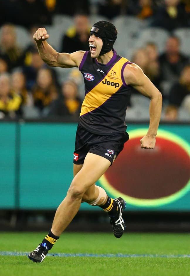 MELBOURNE, AUSTRALIA - MAY 14: Ben Griffiths of the Tigers celebrates after kicking a goal during the 2016 AFL Round 08 match between the Richmond Tigers and the Sydney Swans at the Melbourne Cricket Ground, Melbourne on May 14, 2016. (Photo by Scott Barbour/AFL Media)