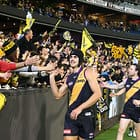 MELBOURNE, AUSTRALIA - MAY 14:  Ben Griffiths of the Tigers celebrates with Tigers supporters in the crowd after kicking the match-winning goal after the final siren during the 2016 AFL Round 08 match between the Richmond Tigers and the Sydney Swans at the Melbourne Cricket Ground, Melbourne on May 14, 2016. (Photo by Scott Barbour/AFL Media)