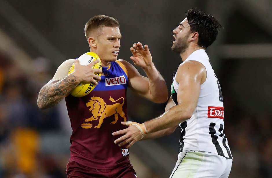 BRISBANE, AUSTRALIA - MAY 14: Dayne Beams of the Lions fends of Alex Fasolo of the Magpies during the 2016 AFL Round 08 match between the Brisbane Lions and the Collingwood Magpies at The Gabba, Brisbane on May 14, 2016. (Photo by Michael Willson/AFL Media)