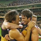 MELBOURNE, AUSTRALIA - MAY 14:  Sam Lloyd of the Tigers is congratulated by Alex Rance of the Tigers after kicking the match-winning goal after the final siren during the 2016 AFL Round 08 match between the Richmond Tigers and the Sydney Swans at the Melbourne Cricket Ground, Melbourne on May 14, 2016. (Photo by Scott Barbour/AFL Media)