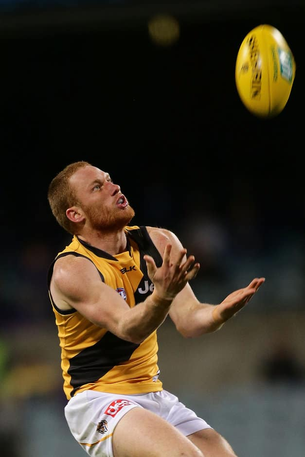 PERTH, AUSTRALIA - MAY 21: Nick Vlastuin of the Tigers marks the ball during the 2016 AFL Round 09 match between the Fremantle Dockers and the Richmond Tigers at Domain Stadium on May 21, 2016 in Perth, Australia. (Photo by Will Russell/AFL Media)