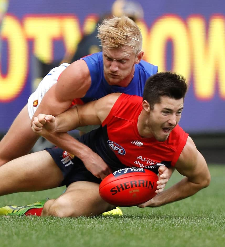 MELBOURNE, AUSTRALIA - MAY 22: Alex Neal-Bullen of the Demons  is tackled by Nick Robertson of the Lions during the 2016 AFL Round 09 match between the Melbourne Demons and the Brisbane Lions at the Melbourne Cricket Ground on May 22, 2016 in Melbourne, Australia. (Photo by Michael Willson/AFL Media)