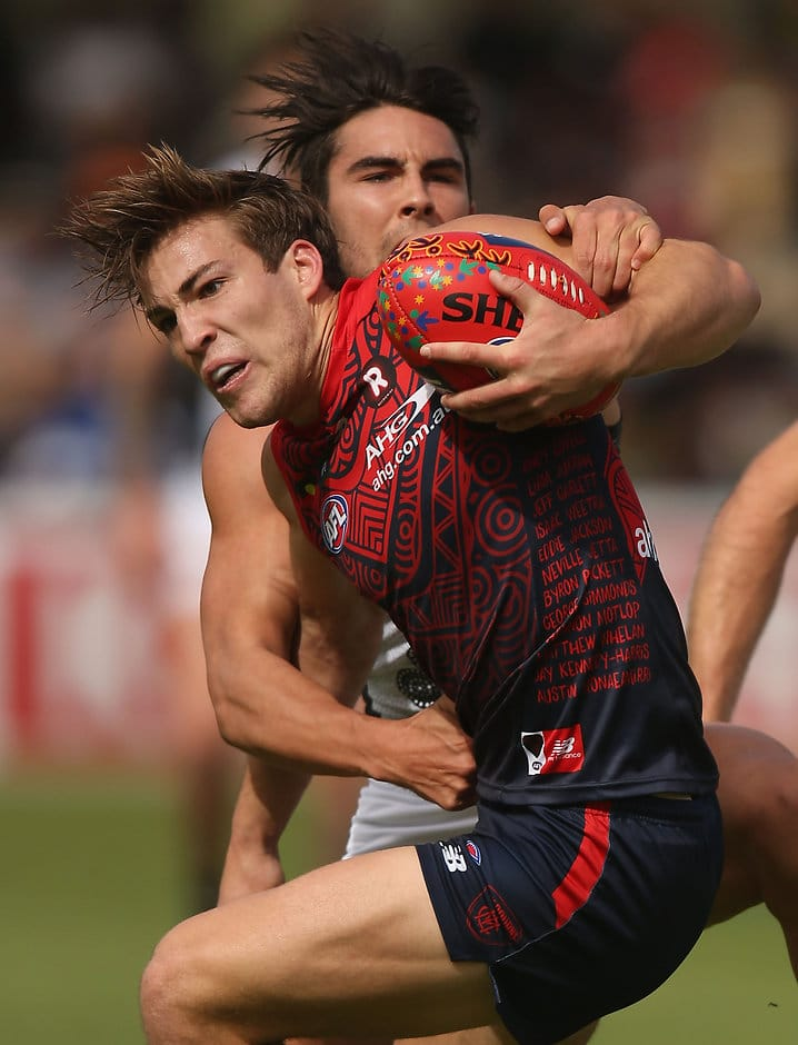 ALICE SPRINGS, AUSTRALIA - MAY 28: Jack Viney of the Demons is tackled by Chad Wingard of the Power during the 2016 AFL Round 10 match between the Melbourne Demons and Port Adelaide Power at TIO Traeger Park on May 28, 2016 in Alice Springs, Australia. (Photo by Sean Garnsworthy/AFL Media)