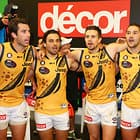 MELBOURNE, AUSTRALIA - MAY 28: Alex Rance of the Tigers, Sam Lloyd of the Tigers, Brett Deledio of the Tigers and Shaun Grigg of the Tigers sing the song in the rooms after winning during the 2016 AFL Round 10 Dreamtime at the G match between the Essendon Bombers and the Richmond Tigers at the Melbourne Cricket Ground on May 28, 2016 in Melbourne, Australia. (Photo by Scott Barbour/AFL Media)