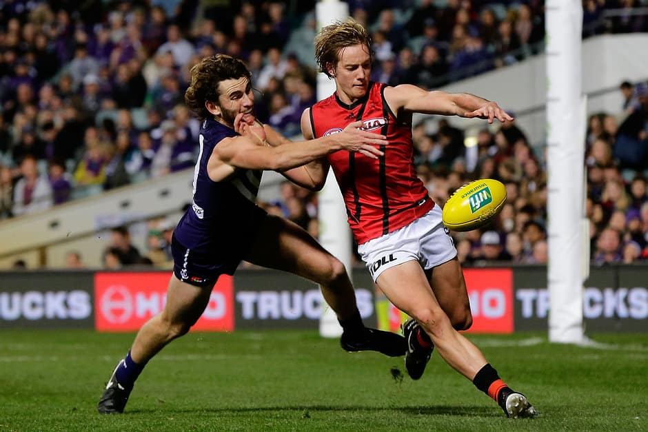 PERTH, AUSTRALIA - JUNE 04: Will Hams of the Bombers kicks the ball under pressure from Connor Blakely of the Dockers during the 2016 AFL Round 11 match between the Fremantle Dockers and the Essendon Bombers at Domain Stadium on June 4, 2016 in Perth, Australia. (Photo by Will Russell/AFL Media)
