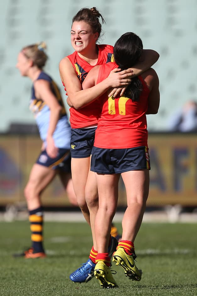 ADELAIDE, AUSTRALIA - JUNE 05: Ebony Marinoff and Kirsty Degabriele of SA celebrate a goal during the 2016 AFL Womens match between South Australia and NSW ACT at the Adelaide Oval on June 05, 2016 in Adelaide, Australia. (Photo by James Elsby/AFL Media)