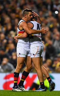 Tex Walker and Mitch McGovern celebrate a goal on Saturday night