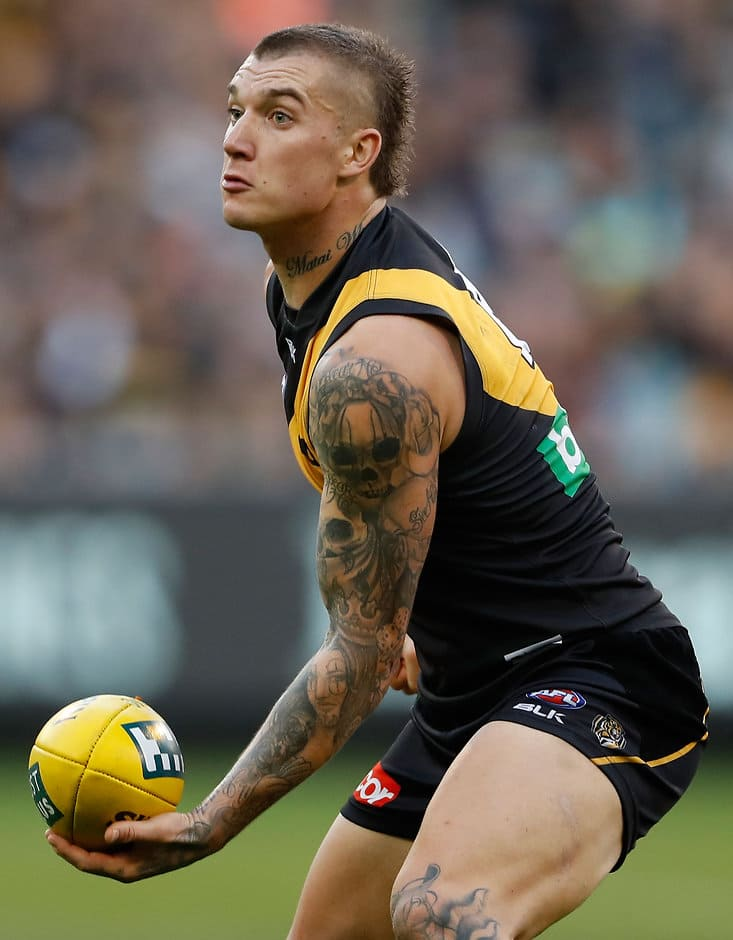MELBOURNE, AUSTRALIA - JUNE 12: Dustin Martin of the Tigers in action during the 2016 AFL Round 12 match between the Richmond Tigers and the Gold Coast Suns at the Melbourne Cricket Ground on June 12, 2016 in Melbourne, Australia. (Photo by Adam Trafford/AFL Media)