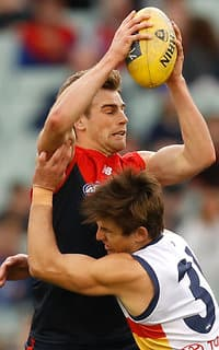 Dom Tyson is tackled by Jarryd Lyons at the MCG