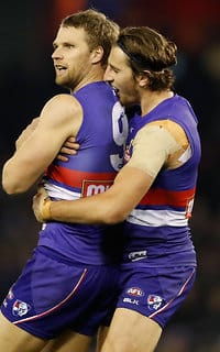 Jake Stringer and Marcue Bontempelli celebrate a goal against Richmond on Saturday night