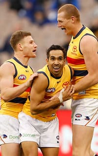 A jubilant Eddie Betts celebrates a goal with Rory Laird and Sam Jacobs
