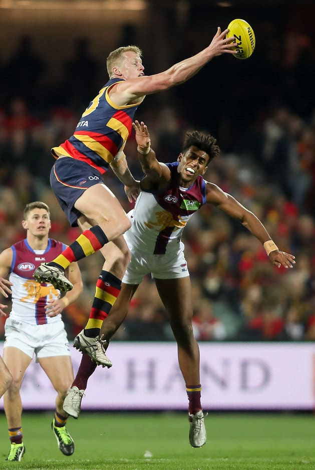 ADELAIDE, AUSTRALIA - AUGUST 06: Reilly O'Brien of the Crows clashes with Archie Smith of the Lions during the 2016 AFL Round 20 match between the Adelaide Crows and the Brisbane Lions at Adelaide Oval on August 06, 2016 in Adelaide, Australia. (Photo by AFL Media)