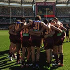 BRISBANE, AUSTRALIA - AUGUST 13: Players of the Lions huddle during the 2016 AFL Round 21 match between the Brisbane Lions and the Carlton Blues at The Gabba on August 13, 2016 in Brisbane, Australia. (Photo by Matt Roberts/AFL Media)