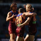 BRISBANE, AUSTRALIA - AUGUST 13: Daniel Rich of the Lions celebrates kicking a goal with team mates during the 2016 AFL Round 21 match between the Brisbane Lions and the Carlton Blues at The Gabba on August 13, 2016 in Brisbane, Australia. (Photo by Matt Roberts/AFL Media)
