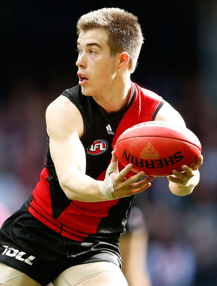 MELBOURNE, AUSTRALIA - AUGUST 14: Acting captain Zach Merrett of the Bombers in action during the 2016 AFL Round 21 match between the Essendon Bombers and the Gold Coast Suns at Etihad Stadium on August 14, 2016 in Melbourne, Australia. (Photo by Adam Trafford/AFL Media)