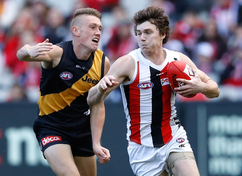 MELBOURNE, AUSTRALIA - AUGUST 20: Blake Acres of the Saints is tackled by Debutante, Callum Moore of the Tigers during the 2016 AFL Round 22 match between the Richmond Tigers and the St Kilda Saints at the Melbourne Cricket Ground on August 20, 2016 in Melbourne, Australia. (Photo by Adam Trafford/AFL Media)