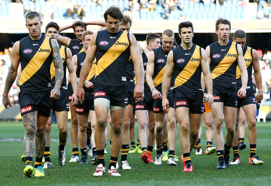 MELBOURNE, AUSTRALIA - AUGUST 20: Tigers players look dejected after a loss during the 2016 AFL Round 22 match between the Richmond Tigers and the St Kilda Saints at the Melbourne Cricket Ground on August 20, 2016 in Melbourne, Australia. (Photo by Adam Trafford/AFL Media)