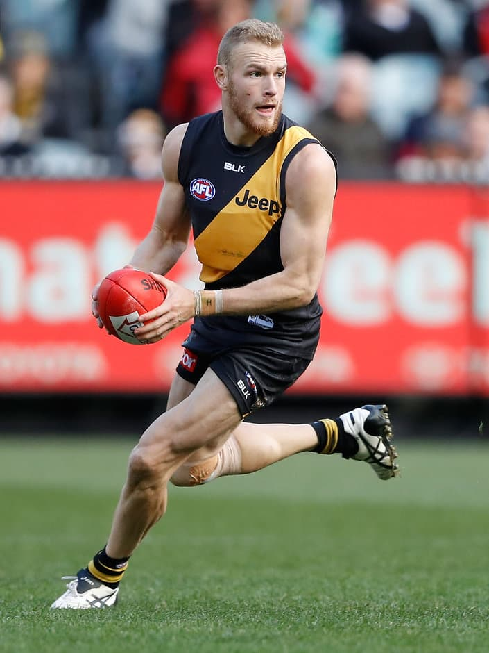 MELBOURNE, AUSTRALIA - AUGUST 20: Andrew Moore of the Tigers in action during the 2016 AFL Round 22 match between the Richmond Tigers and the St Kilda Saints at the Melbourne Cricket Ground on August 20, 2016 in Melbourne, Australia. (Photo by Adam Trafford/AFL Media)
