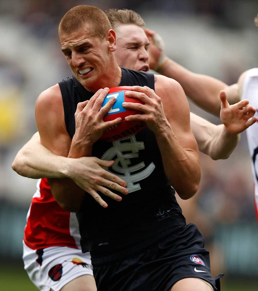 MELBOURNE, AUSTRALIA - AUGUST 21: Liam Jones of the Blues is tackled by Tom McDonald of the Demons during the 2016 AFL Round 22 match between the Carlton Blues and the Melbourne Demons at the Melbourne Cricket Ground on August 21, 2016 in Melbourne, Australia. (Photo by Michael Willson/AFL Media)
