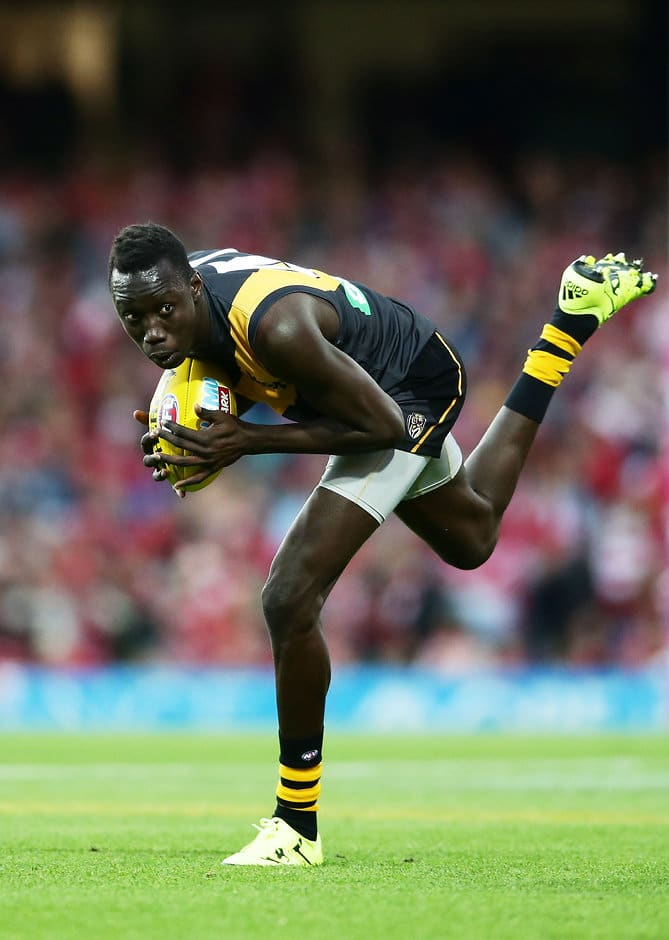 SYDNEY, AUSTRALIA - AUGUST 27:  Mabior Chol of the Tigers runs during the round 23 AFL match between the Sydney Swans and the Richmond Tigers at Sydney Cricket Ground on August 27, 2016 in Sydney, Australia.  (Photo by Matt King/Getty Images/AFL Media)