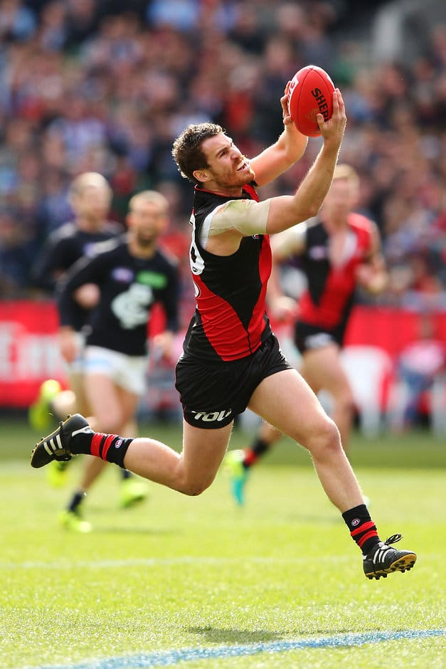 MELBOURNE, AUSTRALIA - AUGUST 27: Nick Kommer of the Bombers marks the ball during the 2016 AFL Round 23 match between the Essendon Bombers and the Carlton Blues at the Melbourne Cricket Ground on August 27, 2016 in Melbourne, Australia. (Photo by Michael Dodge/AFL Media)