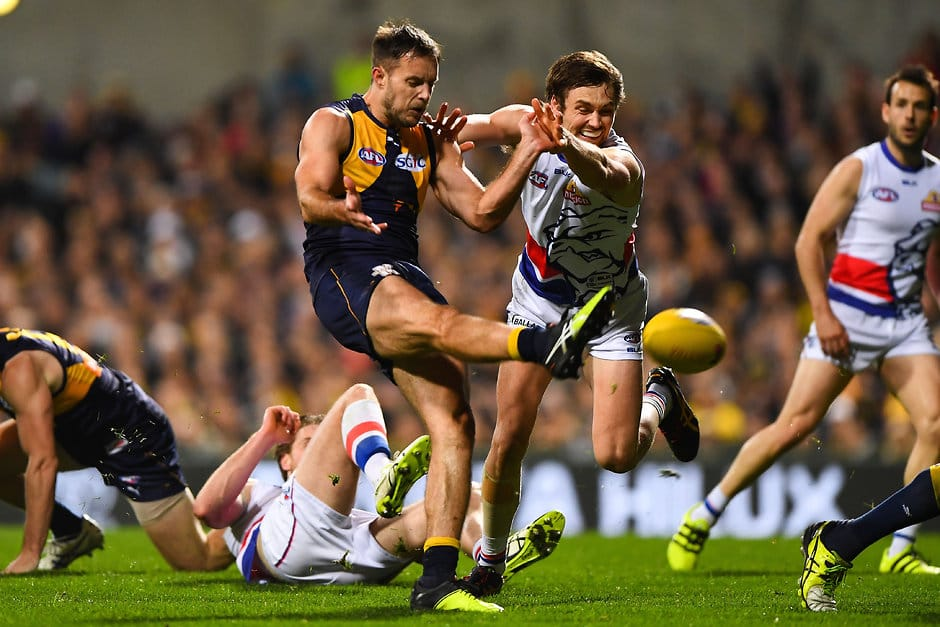 PERTH, AUSTRALIA - SEPTEMBER 08: Mitch Brown of the Eagles snaps on goal past Joel Hamling of the Bulldogs during the 2016 AFL Second Elimination Final match between the West Coast Eagles and the Western Bulldogs at Domain Stadium on September 08, 2016 in Perth, Australia. (Photo by Daniel Carson/AFL Media)