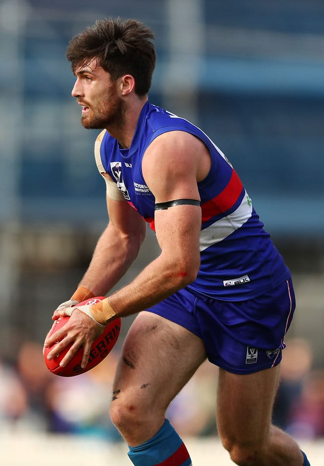 MELBOURNE, AUSTRALIA - SEPTEMBER 11: Tom Campbell of the Footscray Bulldogs runs with the ball during the VFL 2nd Semi Final match between Footscray Bulldogs and Essendon  at North Port Oval on September 11, 2016 in Melbourne, Australia.  (Photo by Scott Barbour/AFL Media)