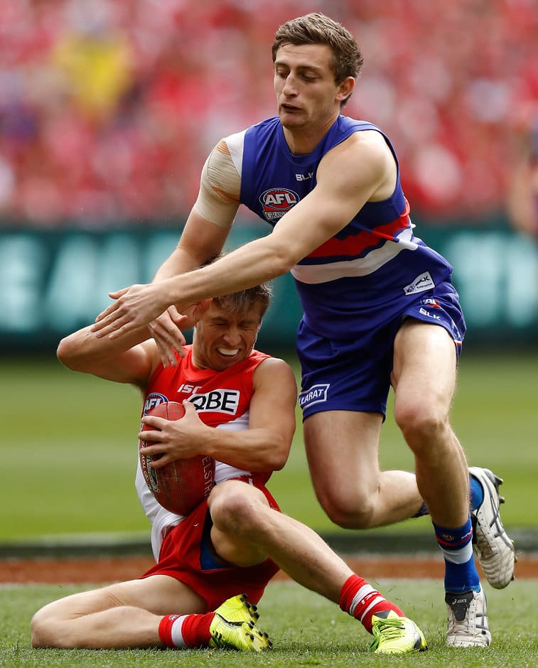MELBOURNE, AUSTRALIA - OCTOBER 01: Kieren Jack of the Swans is tackled by Fletcher Roberts of the Bulldogs during the 2016 Toyota AFL Grand Final match between the Sydney Swans and the Western Bulldogs at the Melbourne Cricket Ground on October 01, 2016 in Melbourne, Australia. (Photo by Michael Willson/AFL Media)