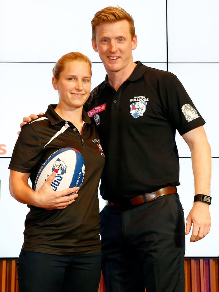 MELBOURNE, AUSTRALIA - OCTOBER 12: The number five draft pick for the Western Bulldogs Jamie Lambert is announced and poses with coach Paul Groves on stage during the 2016 NAB AFLW Draft at NAB Building on October 12, 2016 in Melbourne, Australia. (Photo by Justine Walker/AFL Media)