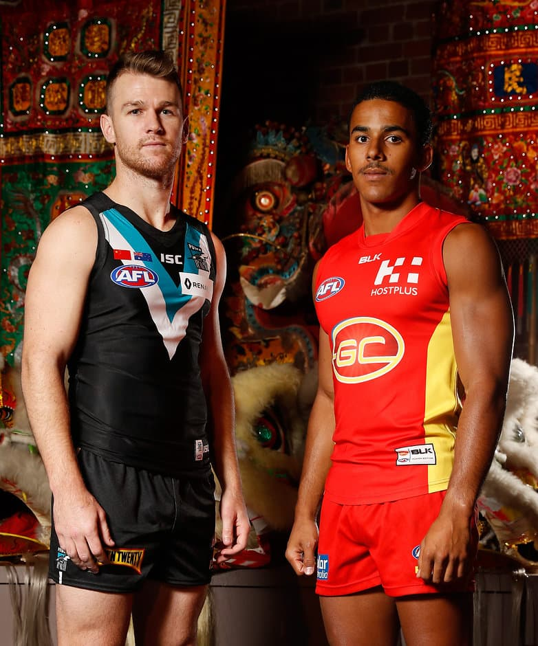 MELBOURNE, AUSTRALIA - OCTOBER 26: Robbie Gray of the Power (left) and Touk Miller of the Suns (right) pose for a photograph during an AFL press conference announcing the first AFL match for premiership points in China between Port Adelaide and Gold Coast at The Chinese Museum Melbourne, Australia on October 26, 2016. (Photo by Michael Willson/AFL Media)