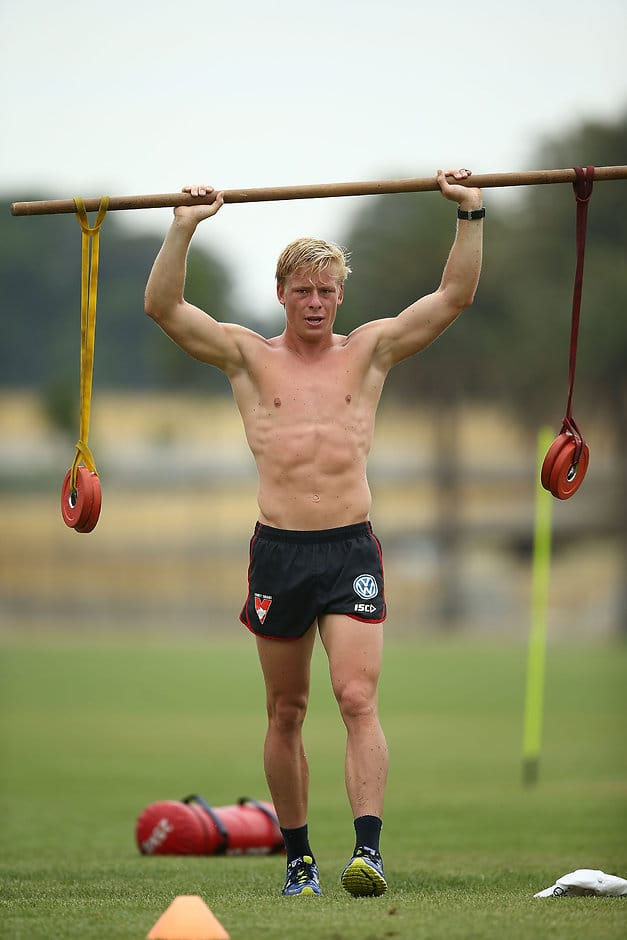 SYDNEY, AUSTRALIA - DECEMBER 05:  Isaac Heeney performs strength drills during a Sydney Swans AFL pre-season training session at Lakeside Oval on December 5, 2016 in Sydney, Australia.  (Photo by Mark Metcalfe/Getty Images)