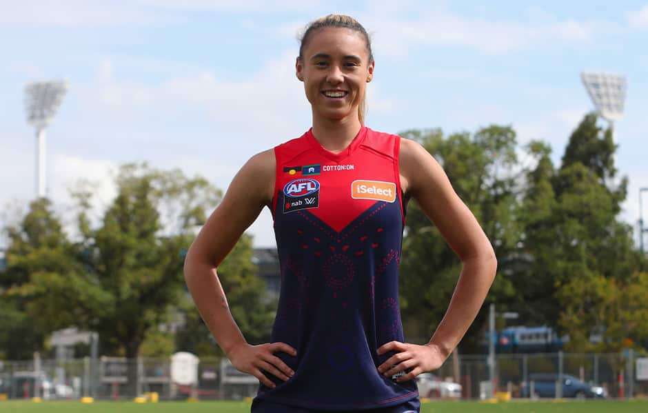Aliesha Newman pulls on Melbourne's 2019 Indigenous guernsey.  - AFLW