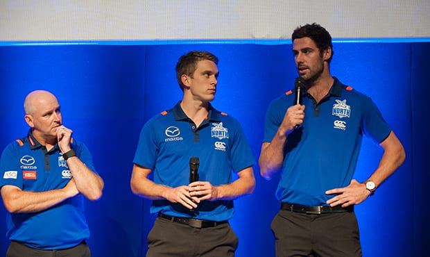 Coach David Loader looks on as Chris Jansen (middle) and Michael Close (right) are announced as co-captains.