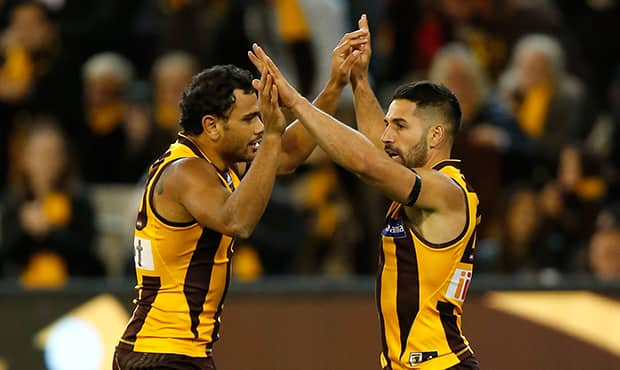 Hawks duo Cyril Rioli and Paul Puopolo will miss this weekend's clash.