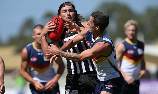 Tom Gray wins the ball against the Crows in a trial game at Alberton Oval [pic: Chris Kelly/PAFC]