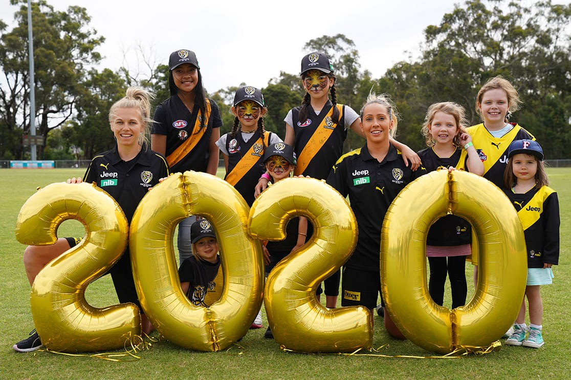 Jacqui Graham (left, runner-up in 2018 Richmond VFLW B&F) and Laura Bailey (right, former Bulldogs AFLW player, played 6 games for Richmond VFLW in 2018) with junior Tiger fans at the Christmas in Cardinia event in Beaconsfield on Tuesday. (Photo: Sean Garnsworthy/RichmondFC) - AFLW,Richmond Tigers