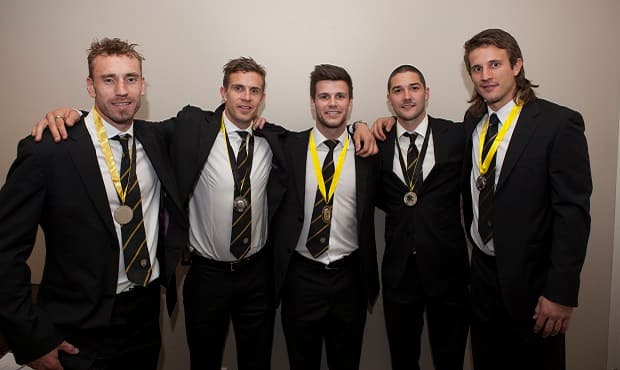 2012 Jack Dyer Medal winner Trent Cotchin win the remainder of the top 5 pose for a photo celebrating their wins.