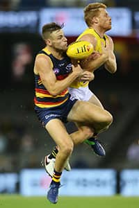 Brodie Smith and Nick Vlastuin compete for the ball