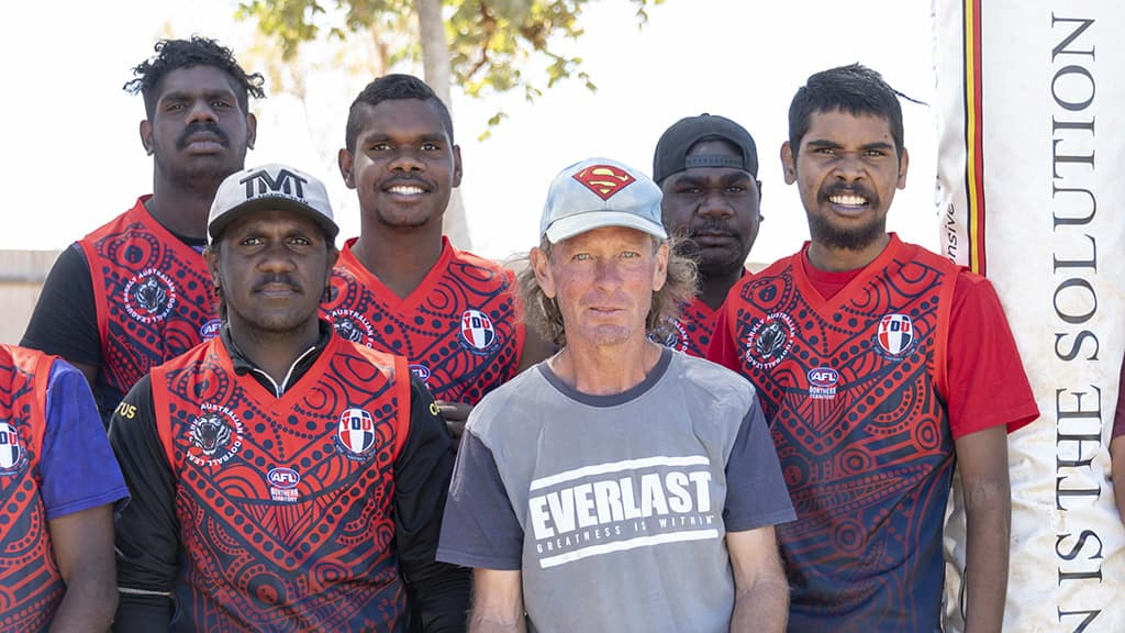 Stewart Willey (centre) is Youth Development Unit (YDU) Football Club's 'Superman' - AFL,Lifestyle,Community,Inspire,Branded